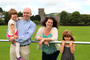 Gareth and the family in Llandysul Memorial Park with St Tysul Church in the Background
